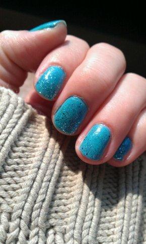 Blue sparkle nails.